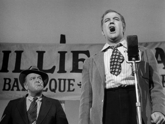 "A hungover Willie Stark (Broderick Crawford) speaks from the heart at a public barbecue in ""All the King's Men."""