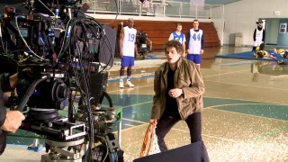 Andew Garfield films Spider-Man's slam dunk scene with mats on the ground for extras.