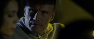DEA agent Evan Maxwell (Dolph Lundgren) worries about the danger that his girlfriend's undercover work puts her in.