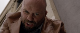Detective Jack Reiley is a tough and dirty cop, or at least that's what Randy Couture is going for.