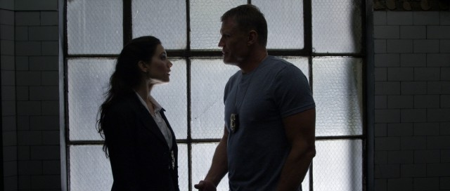 "DEA agents Royce (Carly Pope) and Maxwell (Dolph Lundgren) are all in for a big bust in ""Ambushed."""