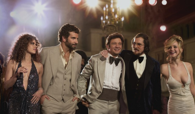 "The five principals of ""American Hustle"" -- Amy Adams, Bradley Cooper, Jeremy Renner, Christian Bale, and Jennifer Lawrence -- share a glitzy walk."