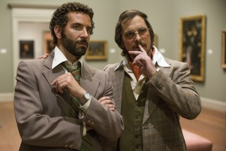 Irving (Christian Bale) points out a fake hanging in the Frick Museum to Richie DiMaso (Bradley Cooper).