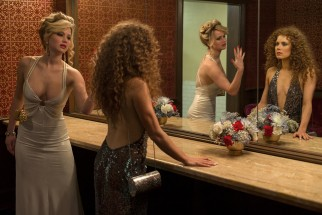 Irving's wife Rosalyn (Jennifer Lawrence) and mistress/business partner Edith/Sydney (Amy Adams) confront one another in the Grand Old AC Hotel powder room in their first shared encounter.