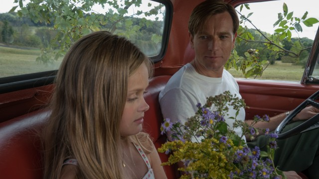 "Swede Levov (Ewan McGregor) stops to smell the flowers with his stuttering daughter Merry (Hannah Nordberg) in ""American Pastoral."""
