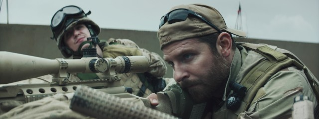 "A bulked-up Bradley Cooper plays Chris Kyle, the titular hero of ""American Sniper."""