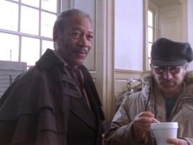 "Morgan Freeman discusses the movie while Steven Spielberg stirs his coffee in ""The Making of 'Amistad.'"""
