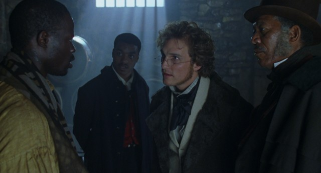 Cultures clash as Cinque (Djimon Hounsou) meets with Baldwin (Matthew McConaughey) and abolitionist Theodore Joadsen (Morgan Freeman) with James Covey (a young Chiwetel Ejiofor) interpreting.