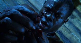 "Cinque (Djimon Hounsou) pulls out the nail that will start a revolt in the opening sequence of ""Amistad."""