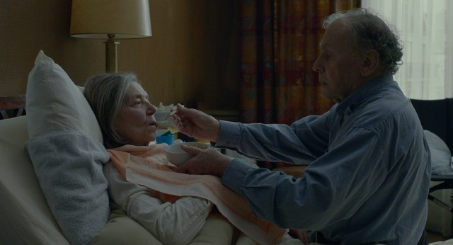 "In #64, ""Amour"", Georges Laurent (Jean-Louis Trintignant) spoon-feeds his wife Anne (Emmanuelle Riva) after a stroke leaves her partially paralyzed and highly dependent."