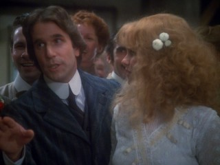 At a Christmas party in his younger days, Benedict Slade (Henry Winkler) explains the value of mass production.