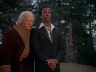 The Ghost of Christmas Future (Dorian Harewood) dresses like a cool guy from the 1970s.