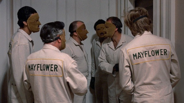 The only thing these masked Mayflower men move are the valuables inside a Manhattan apartment building.