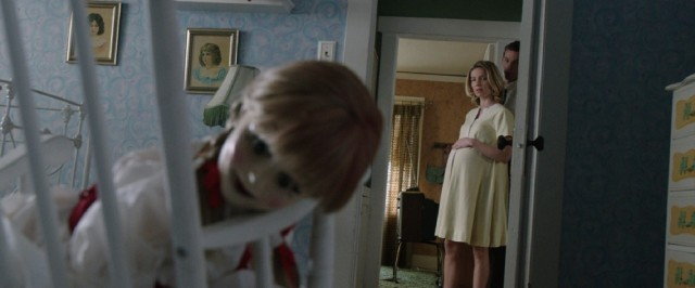 "Annabelle, that creepy doll being used as a demon's conduit, enters and upsets the lives of an expectant California couple in 2014's ""Annabelle."""