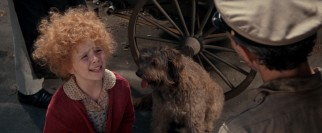 Annie (Aileen Quinn) pleads with a pound officer to let her newly-adopted dog Sandy remain free.