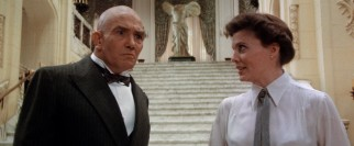 Grace (Ann Reinking) has to defend her selection of a female orphan for bald billionaire Oliver Warbucks (Albert Finney).