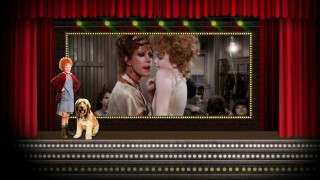 A posed Annie and Sandy seem okay with Miss Hannigan's rough treatment of her orphans on the Blu-ray's menu.