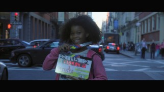 Quvenzhané Wallis cutely holds the clapboard at the start of the bloopers reel.