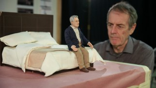 "An animator positions Michael Stone on his hotel bed in ""Intimacy in Miniature."""