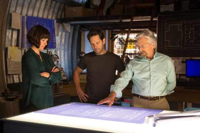 To save the world, Hope van Dyne (Evangeline Lilly), Scott Lang (Paul Rudd), and Hank Pym (Michael Douglas) brainstorm.