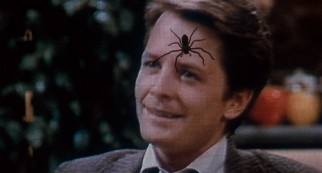 "A televised Alex P. Keaton (Michael J. Fox) doesn't stand a chance against an ""Arachnophobia"" spider. (Second pressing)"