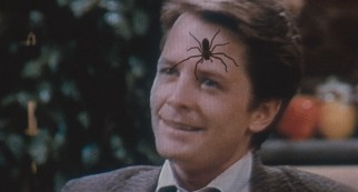 "A televised Alex P. Keaton (Michael J. Fox) doesn't stand a chance against an ""Arachnophobia"" spider. (Recalled original pressing)"