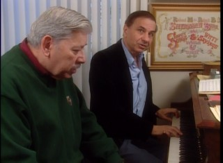 "Richard Sherman plays piano and sings, while his older brother Robert stares off into space in ""The Aristocrats of Disney Songs."""