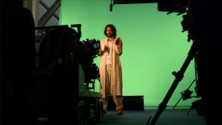 "Russell Brand performs a scene on green screen in ""Making 'Army of One.'"""