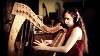 "Cécile Corbel both sings and plays the harp in her music video for ""Arrietty's Song."""