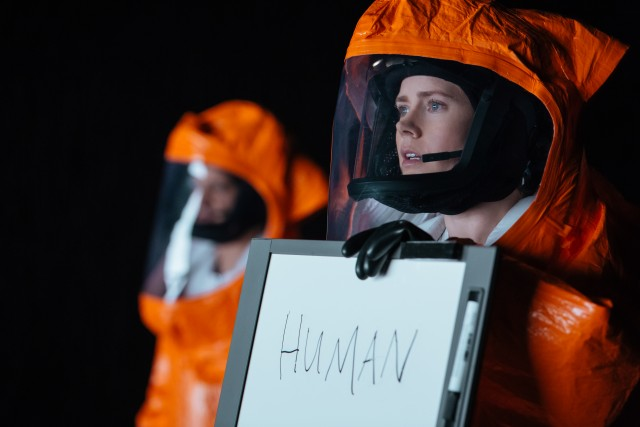 "In ""Arrival"", linguist Louise Banks (Amy Adams) tries to acquaint herself with alien visitors' language and to teach them English."