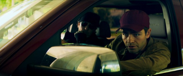 "Undercover cop Sal (John Cusack) helps JP (Adrian Grenier) go looking into his brother's ransomed abduction in ""Arsenal."""