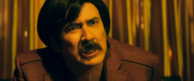 A wig, fake mustache, and prosthetic nose help Nicolas Cage look more outrageous than usual as Eddie King, the closest thing that Biloxi, Mississippi has to a gangster.