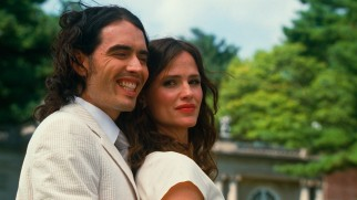 Arthur (Russell Brand) forces a smile for his engagement photo with Susan Johnson (Jennifer Garner).