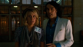 Naomi Quinn (Greta Gerwig) is amazed by the sight of the empty Grand Central Terminal that Arthur (Russell Brand) has arranged for them.