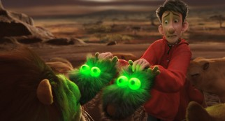 In Africa, Arthur finds that his glowing reindeer slippers temporarily interest the man-eating lions that surround him.