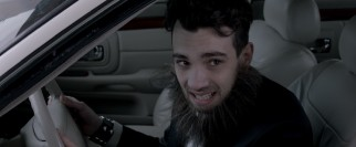A clean record makes Francie (Jay Baruchel) the one to drive across the border in a fake beard.