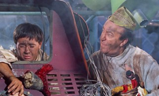 Apprentice Grumio (Tommy Kirk) and his master Toymaker (Ed Wynn) make a mess out of Toyland in the film's final act.