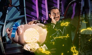 Barnaby (Ray Bolger) shows his henchmen the money with a spotlight that projects double-lined dollar signs.