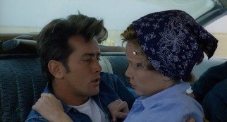 Denim jacketed Kit (Martin Sheen) and head-kerchiefed Holly (Sissy Spacek) share a loverly moment in a car.