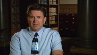 John Michael Higgins discusses his dolphin-loving character, Principal Wally Snur.