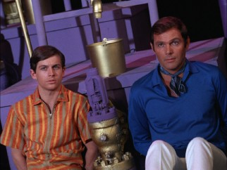 Outside of their costumes, Dick Grayson (Burt Ward) and Bruce Wayne (Adam West) are just a couple of groovy bachelors of the late 1960s.