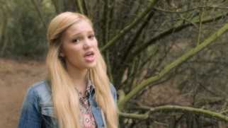 "Olivia Holt keeps calm and sings outdoors in her ""Carry On"" music video."