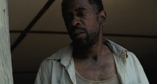Seemingly widowed Wink (Dwight Henry) parents Hushpuppy with more stubbornness than common sense.