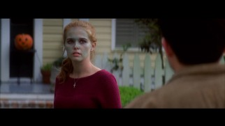 Faded green make-up doesn't prevent Emily Asher (Zoey Deutch) from getting a kiss from Ethan in this deleted Halloween scene.