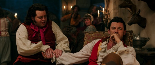 Luke Evans plays Belle's macho suitor Gaston and Josh Gad is his subtly smitten comic sidekick LeFou.
