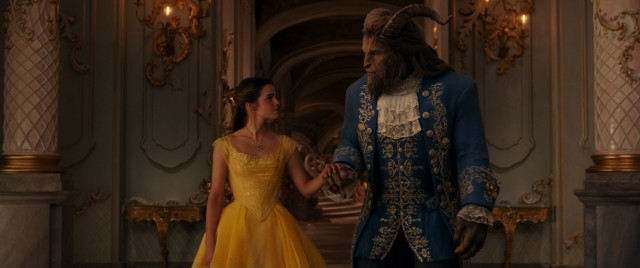 After a rough start, Belle (Emma Watson) and Beast (motion captured Dan Stevens) warm enough to share a ballroom dance in fancy attire.