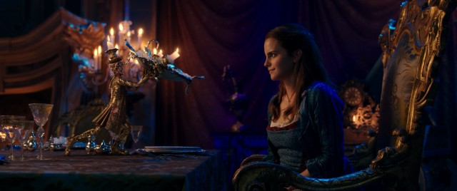 Candelabra Lumiere (Ewan McGregor) and other enchanted items in the Beast's castle do their part to make Belle (Emma Watson) feel less like a prisoner.