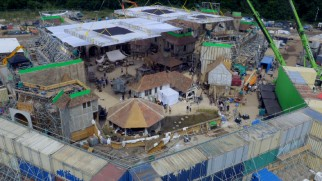 "An aerial shot shows just how much provincial village was constructed for the opening number ""Belle."""