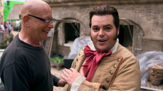 "Josh Gad clowns around with a crew member on the set in ""A Beauty of a Tale."""