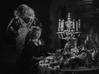 Beast offers Belle feasts on an armed dinner table as his houseguest.